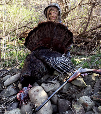 Katie Adams with her first turkey, taken with her Great Grandma Adams' single shot .410 On the facing page she is shown with her first of two squirrels shot on her second squirrel hunt.