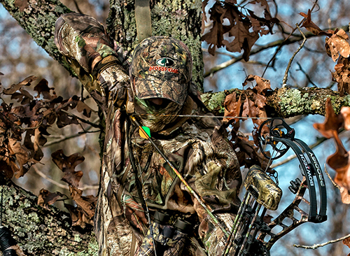 Try to position tree stands in trees that offer natural backing of limbs, leaves or other trees to break up your silhouette.