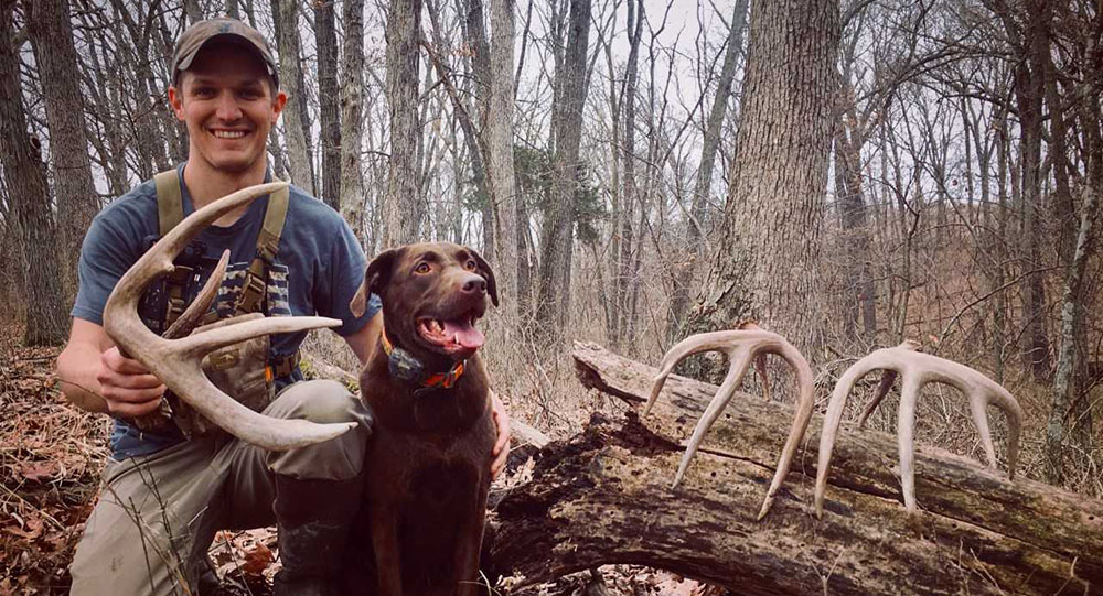 Alex Foster and his dog with some great shed antlers